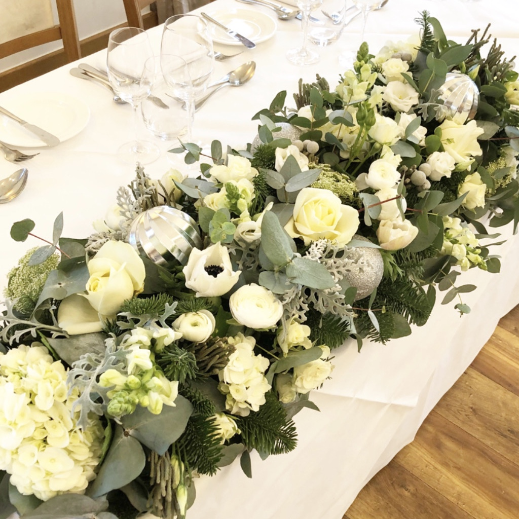White and green top table arrangement